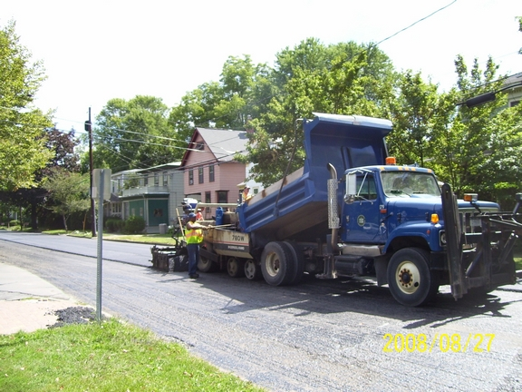 Public Works Truck and Crew Paving a Street
